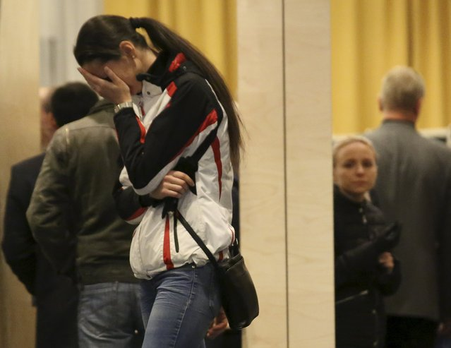 A relative of victims of a Russian airliner which crashed in Egypt, mourns at a hotel near Pulkovo airport in St. Petersburg, Russia, October 31, 2015. (Photo by Peter Kovalev/Reuters)