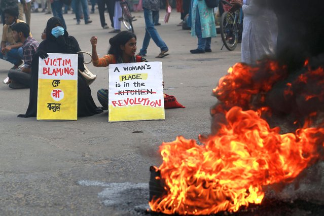 Students and activists block roads as they protest against recent alleged rape and torture of a woman in the southern district of Noakhali, in Dhaka on October 21, 2020. (Photo by Rehman Asad/NurPhoto via Getty Images)