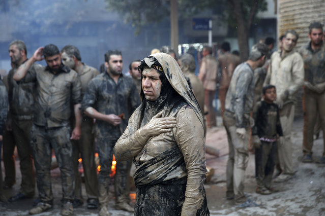 Iranian Shiite Muslims mourn after covering themselves with mud during Ashoura rituals, in Khorramabad, Iran, Wednesday, October12, 2016. Shiites mark Ashoura, the tenth day of the Muslim month of Muharram, to commemorate the martyrdom of Imam Hussein, a grandson of Prophet Muhammad and one of Shiite Islam's most beloved saints, during the 7th century Battle of Karbala in present-day Iraq. (Photo by Ebrahim Noroozi/AP Photo)