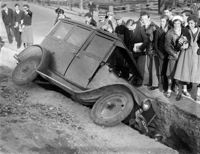 Auto goes into trench in Peabody Sq., 1931. (Photo by Leslie Jones)