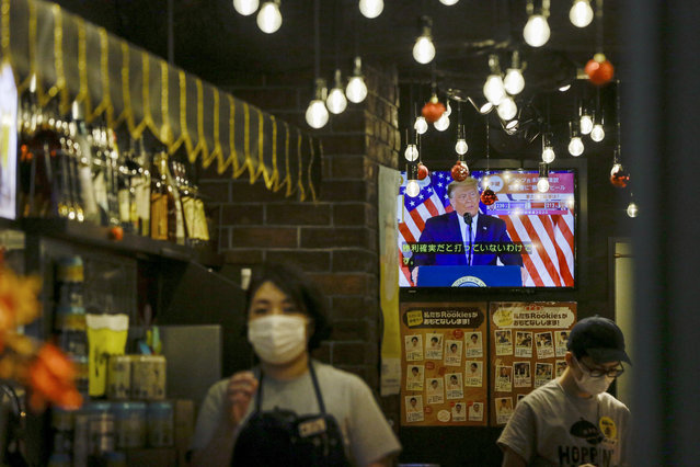 President Donald Trump speaking from the White House is projected on a television at a restaurant Wednesday, November 4, 2020 in Tokyo. (Photo by Kiichiro Sato/AP Photo)