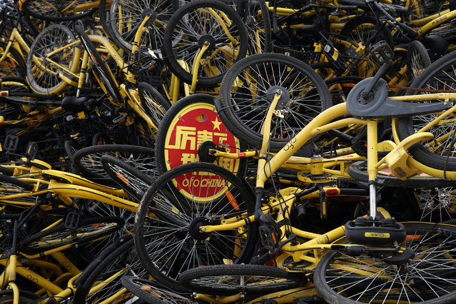 Ofo shared bicycles are seen piled up at a vacant lot in Xiamen, Fujian province, China, 2017. (Photo by Reuters/China Stringer Network)