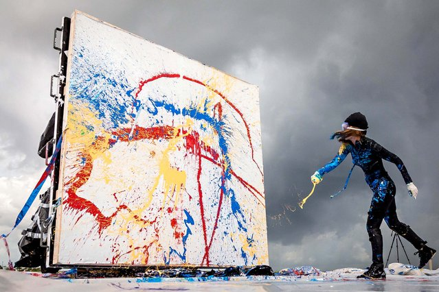 Princess Tarinan works on a canvas. (Photo by Thomas Cordy/The Palm Beach Post)
