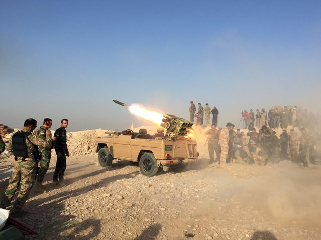 Peshmerga forces located in Duberdan village at Bashiqa front attack Daesh targets with the Katyusha rocket launchers during the operation to retake Iraq's Mosul from Daesh, in Mosul, Iraq on October 20, 2016. A much anticipated Mosul offensive to liberate the city from Daesh began midnight of 16th of October. (Photo by Ferhat Jahan Panah/Anadolu Agency/Getty Images)