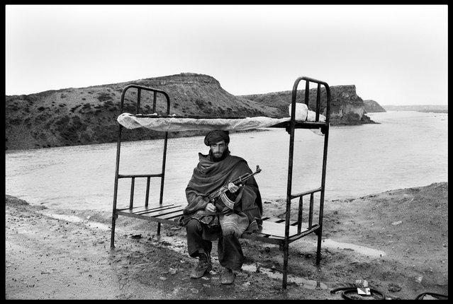 Near Kabul, Afghanistan, 1992. A mujahid of the Hezbi-Islami guards the road to the capital. (Photo by Abbas Attar/Magnum Photos)