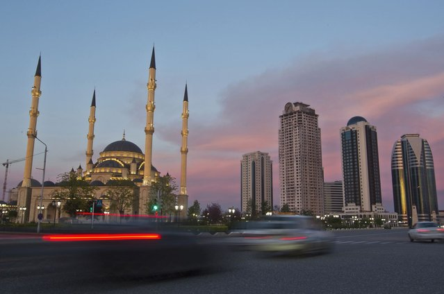 Cars drive along Akhmad Kadyrov Avenue, with the Heart of Chechnya mosque and skyscrapers in the background in the Chechen capital Grozny April 27, 2013. (Photo by Maxim Shemetov/Reuters)