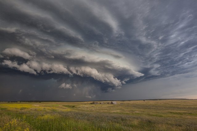Double tornadoes, lightning storms and rotating supercells – this is what it's like to chase storms for a year. These dramatic images show apocalyptic weather throughout 2014 from a lightning storm to a pair of rainbows. Roger Hill, 57, has been chasing storms in the United States for thirty years and runs a tour operation with his wife Caryn. (Photo by Roger Hill/Barcroft Media)