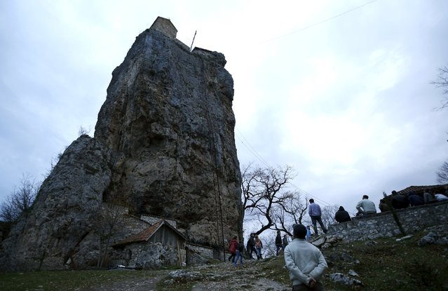A local man looks at the church on top of the Katskhi Pillar, a rock mass about 40 meters high, in the village of Katskhi, Georgia, November 27, 2015. (Photo by David Mdzinarishvili/Reuters)
