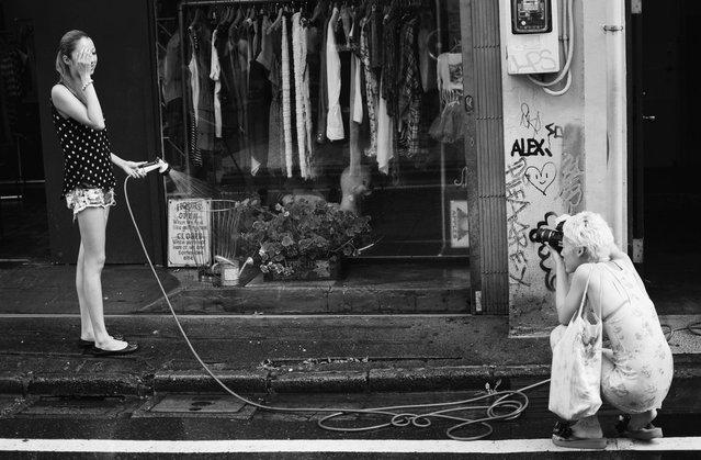 The blonde photographer (and her fleeting subject). Harajuku, 2012. (Davide Filippini)