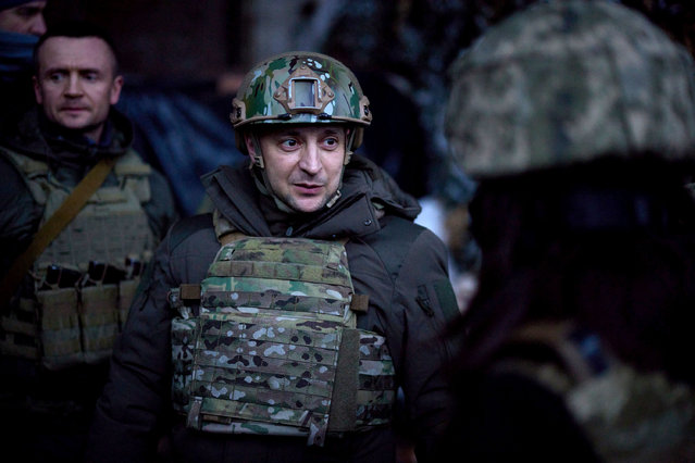 This handout picture taken and released by the Ukrainian presidential press service on February 11, 2021, shows President Volodymyr Zelensky visiting the frontline with Russian-backed separatists in Donetsk region, Ukraine. (Photo by Handout/Ukrainian Presidential Press Service/AFP Photo)