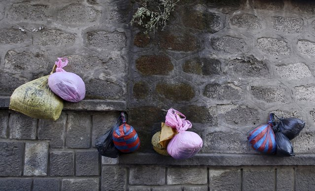A vendor's bags hang on a wall in the early hours of the morning at the Mercato market in Addis Ababa October 8, 2015. (Photo by Tiksa Negeri/Reuters)