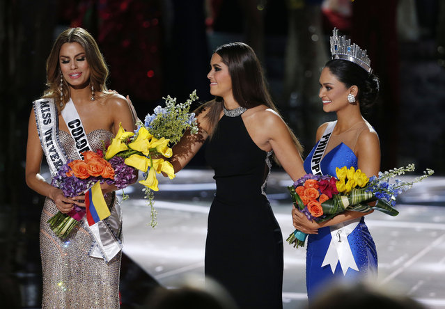 Former Miss Universe Paulina Vega, center,  takes away the flowers and sash from Miss Colombia Ariadna Gutierrez, left, before giving them to Miss Philippines Pia Alonzo Wurtzbach, right, at the Miss Universe pageant on Sunday, December 20, 2015, in Las Vegas. (Photo by John Locher/AP Photo)
