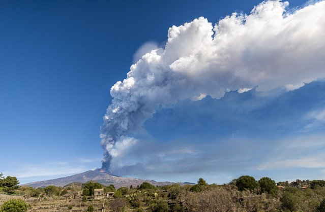 Eruption at Mount Etna, once again Volcano Etna produced a spectacular eruption, this is the twelfth time in twenty-five days. During all the night of March 12, strombolian activity at the Southeast Crater gradually increased, leading to a paroxysmal event after the dawn, the eruptive column several kilometers high was blown by the wind hitting the villages on the slopes of the volcano in an easterly direction, the event ceased in the late morning, photo taken from Nicolosi on March 12, 2021. (Photo by Salvatore Allegra/Anadolu Agency via Getty Images)