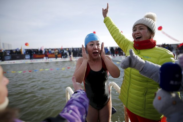 A female swimmer reacts after finishing the competition in a pool carved from thick ice covering the Songhua River during the Harbin Ice Swimming Competition in the northern city of Harbin, Heilongjiang province, January 5, 2016. (Photo by Aly Song/Reuters)