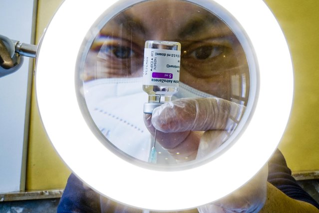 A health worker prepares to administer a dose of AstraZeneca COVID-19 vaccine at a vaccination hub in Naples, Campania, Italy, 13 April 2021. Over one million doses have been injected in Campania so far. (Photo by Ciro Fusco/EPA/EFE)