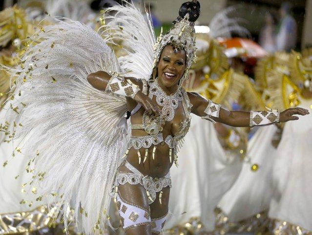 A reveller from the Viradouro samba school participates in the annual carnival parade in Rio de Janeiro's Sambadrome, February 15, 2015. (Photo by Pilar Olivares/Reuters)