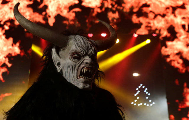 A man dressed as a devil performs during a Krampus show, the traditional parade where people in costumes and masks perform an old ritual to disperse the ghosts of winter, in the southern Bohemian town of Kaplice, December 10, 2016. (Photo by David W. Cerny/Reuters)
