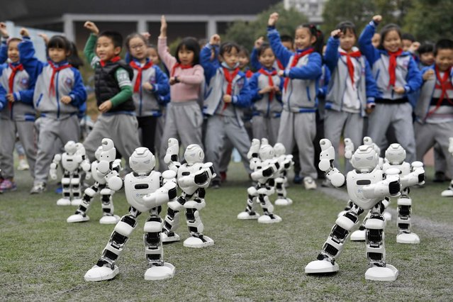 The students are watching the robots doing Tai Chi at the 6th science and technology innovation education festival on 22th November, 2020 in Chengdu, Sichuan, China. (Photo by TPG/Getty Images)
