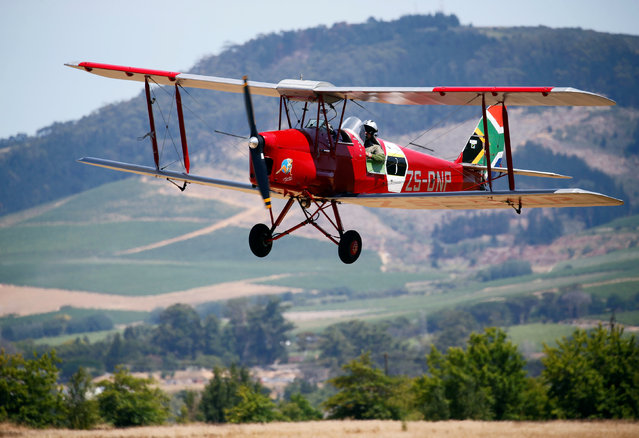 A biplane taking part in the Vintage Air Rally prepares to land, in Stellenbosch, near Cape Town, South Africa December 16, 2016. (Photo by Mike Hutchings/Reuters)