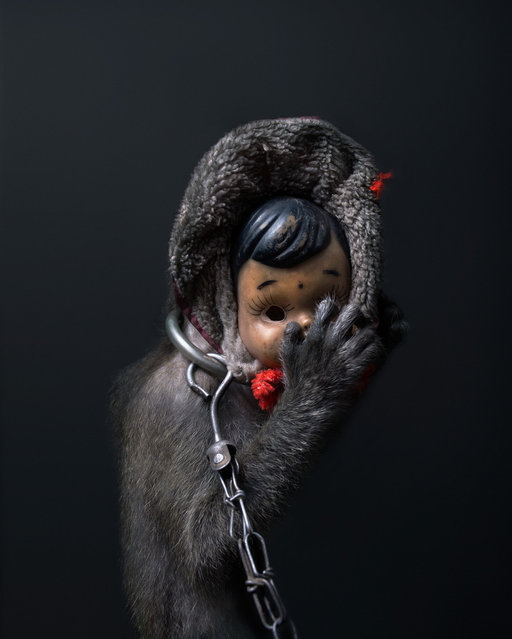 The Monkey and the Mask: Terrifying Portraits of Indonesia's Street-Performing Macaques. (Photo by Perttu Saksa)