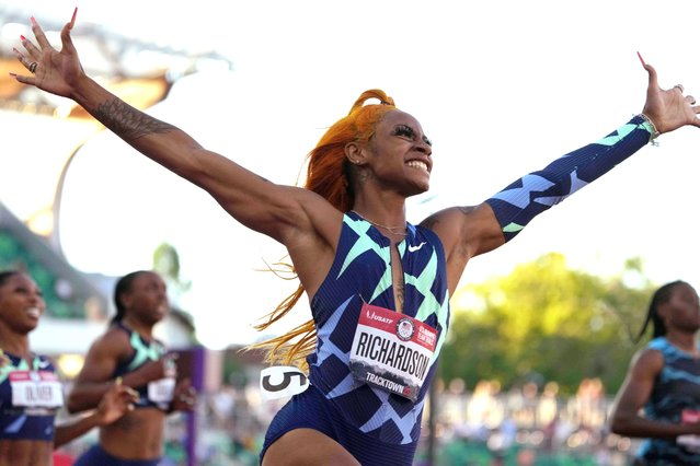 """Sha'Carri Richardson celebrates after winning the women's 100-meter finals in 10.87 during the U.S. Olympic Team Trials at Hayward Field in Eugene, Oregon, June 19, 2021. Billed as American athletics' next star, the 5-foot, 1-inch dynamo didn't disappoint, torching the race with her trademark flourish at the U.S. Olympic trials, raising her arms to the sky and letting out a cheer in front of an elated crowd as she booked her ticket to Tokyo. """"I'm highly blessed and grateful"""", said Richardson, who told a television reporter that she learned last week that her biological mother had passed away. """"Nobody but them and my coach know what I go through on a day-to-day basis"""", pointing to her family, moments after she had embraced her grandmother in the stands. (Photo by Kirby Lee/USA TODAY Sports via Reuters)"""
