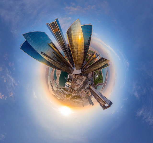 Some of the worlds most iconic cities have been photographed as youve never seen them before  in the shape of tiny round planets. By using a pioneering method of aerial photography, each location can be now seen at a full 360 degree angle. Here: Etihad Towers in Abu Dhabi, Dubai. (Photo by Airpano/Caters News)