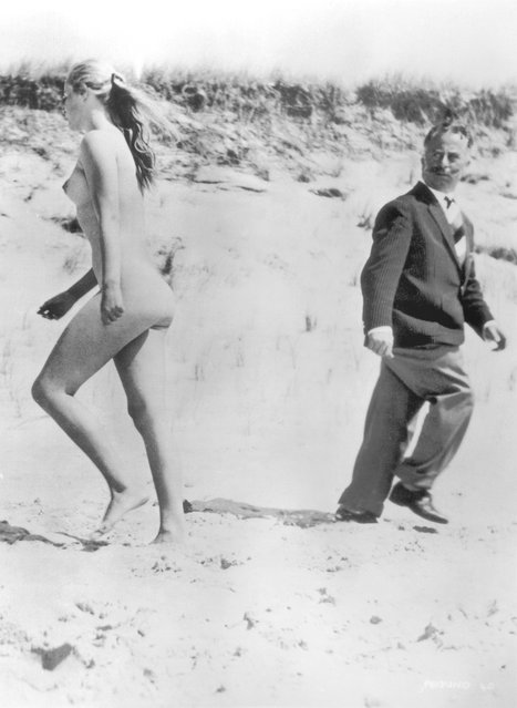 March 1959: A fully-clothed man turns to stare in disgust at a passing naturist on the beach. (Photo by BIPS/Getty Images)