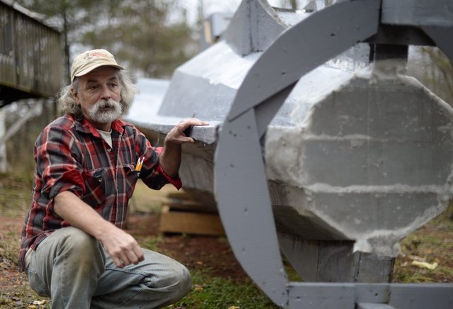 "Danny McWilliams, 56, is seen at his 36-foot-long replica of Walt Disney movie version of the Nautilus submarine from Jules Verne's ""20,000 Leagues Under the Sea"" at his rural home in Ellijay, Georgia, USA, 04 December 2013. (Photo by Erik S. Lesser/EPA)"