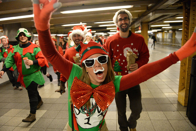 New Yorkers party on the subways and streets of Manhattan for SantaCon. (Photo by Doug Meszler/Splash News)