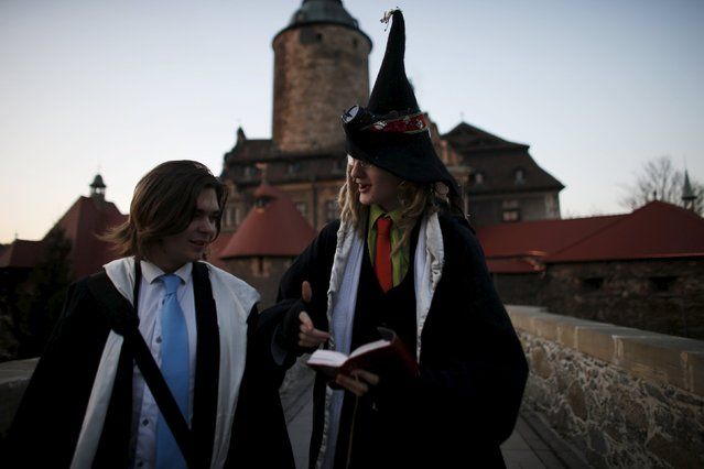 Participants chat as they walk in front of the castle before the role play event at Czocha Castle in Sucha, west southern Poland April 9, 2015. (Photo by Kacper Pempel/Reuters)