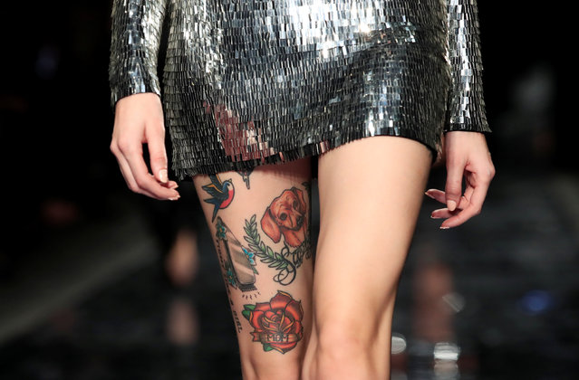 A tattoo of the model who presents a creation by designer Maxime Simoens is seen in detail, as part of his Haute Couture Spring-Summer 2019 collection show for fashion house Azzaro Couture in Paris, France, January 21, 2019. (Photo by Gonzalo Fuentes/Reuters)