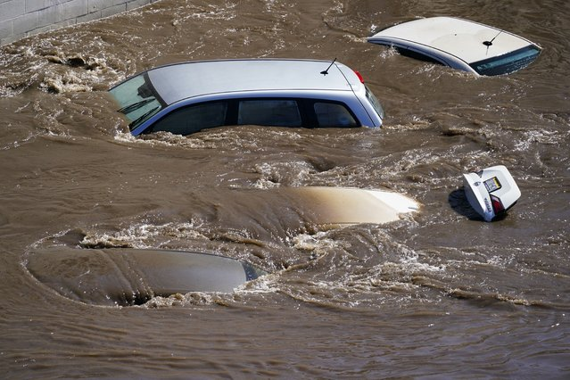Vehicles are under floodwater from Schuylkill River in the Manayunk section of Philadelphia, Thursday, September 2, 2021 in the aftermath of downpours and high winds from the remnants of Hurricane Ida that hit the area. (Photo by Matt Rourke/AP Photo)