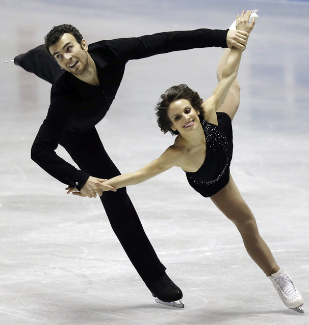 Meagan Duhamel and Eric Radford of  Canada perform during the pairs free skate at the World Team Trophy Figure Skating Championships in Tokyo, Saturday, April 18, 2015. (Photo by Koji Sasahara/AP Photo)