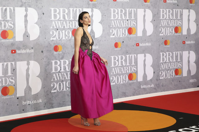 Singer Dua Lipa poses for photographers upon arrival at the Brit Awards in London, Wednesday, February 20, 2019. (Photo by Vianney Le Caer/Invision/AP Photo)
