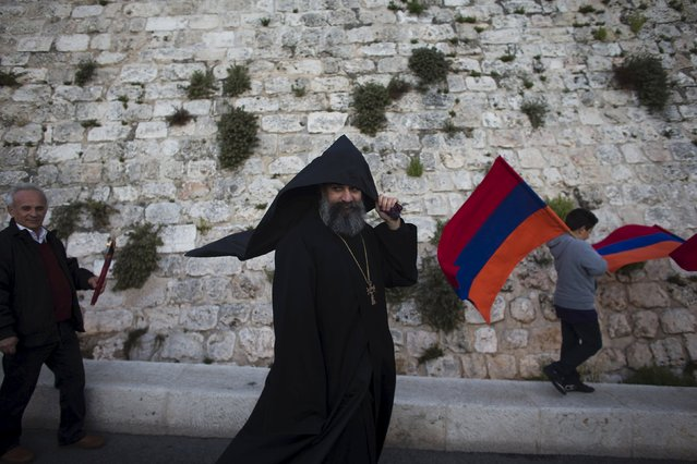 Members of the Armenian community attend a memorial march marking the 100th anniversary of the mass killings of 1.5 million Armenians by Ottoman Turkish forces in Jerusalem's Old City April 23, 2015. Armenia say the massacres during World War One constitute genocide – a term used this month by Pope Francis. Muslim Turkey accepts many Christian Armenians were killed in partisan fighting during the war, but denies it amounted to genocide. (Photo by Ronen Zvulun/Reuters)