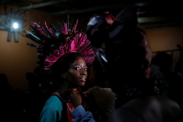 "A model receives final touches behind the scenes of a fashion show featuring African fashion and culture as part of a gala marking the launch of a book called ""African Twilight: The Vanishing Rituals and Ceremonies of the African Continent"" at the African Heritage House in Nairobi, Kenya on March 3, 2019. (Photo by Baz Ratner/Reuters)"