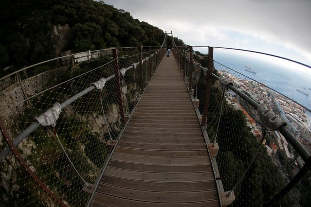 Tourists cross the Windsor Bridge on the top of the Rock in the British overseas territory of Gibraltar, historically claimed by Spain April 18, 2018. (Photo by Jon Nazca/Reuters)