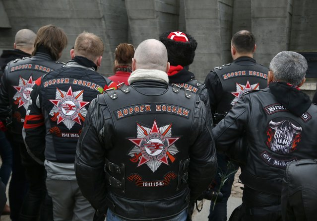 A group of Russian bikers and their supporters visit the memorial complex in the former village of Khatyn, some 60 km (37.5 miles) northeast of Minsk, Belarus, Sunday, April 26, 2015, as they travel to Germany to mark the 70th anniversary of Soviet victory over Nazi Germany. In Khatyn Nazi troops killed 149 villagers, most of them children and women, and burned down their houses in 1943 during WW II. (Photo by Sergei Grits/AP Photo)