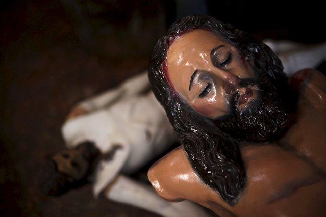 A statue of El Jesus Nazareno is seen at Jose Sabas Gomez's workshop in Apastepeque, El Salvador, March 9, 2016. (Photo by Jose Cabezas/Reuters)