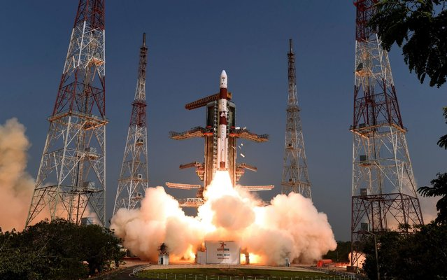 In this photo released by Indian Space Research Organization or ISRO, Polar Satellite Launch Vehicle (PSLV) C-45 lifts from Satish Dhawan Space Centre at Sriharikota in Andhra Pradesh state, around 117 kilometers (72 miles) northeast of Chennai, India, Monday, April 1, 2019. ISRO on Monday successfully launched into orbit an electromagnetic spectrum measurement satellite along with 28 other satellites. (Photo by ISRO via AP Photo)