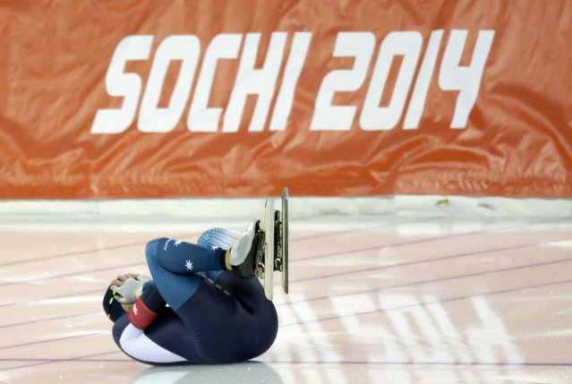 Australia's Daniel Greig curls up after crashing in the first heat of the men's 500-meter speedskating race at the Adler Arena Skating Center during the 2014 Winter Olympics, Monday, February 10, 2014, in Sochi, Russia. (Photo by David J. Phillip/AP Photo)