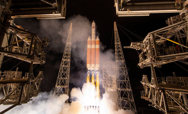 The United Launch Alliance Delta IV Heavy rocket launches NASA's Parker Solar Probe to the Sun at Cape Canaveral, Florida on August 12, 2018. (Photo by NASA via Reuters)