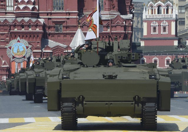 Russian Kurganets-25 armoured personnel carriers drive during the Victory Day parade at Red Square in Moscow, Russia, May 9, 2015. (Photo by Reuters/Host Photo Agency/RIA Novosti)