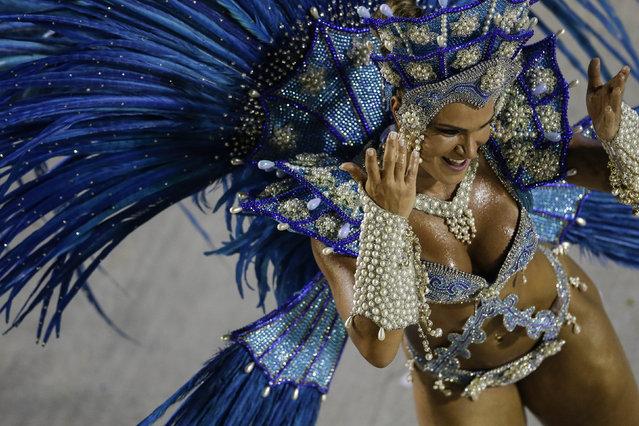 A performer from the Salgueiro samba school parades carnival celebrations at the Sambadrome in Rio de Janeiro, Brazil, Monday, March 3, 2014. (Photo by Felipe Dana/AP Photo)