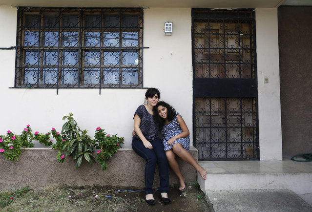 Marisa del Carmen Moreno, 30, and her daughter Alicia Isabel Santa Maria, 10, pose for a photograph outside their home in Panama City February 13, 2014. Marisa is an architect. She finished her education at age 29. When she was a child she wanted to become a veterinarian. She hopes her daughter will grow up to become an artist. Marisa's daughter Alicia Isabel hopes to go to university and would like to become a chef or a painter. (Photo by Carlos Jasso/Reuters)