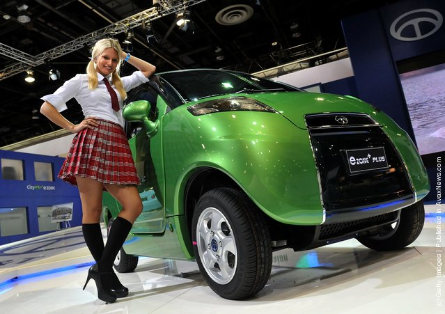 Model Amanda Kaspor of Highland, Michigan poses with the CT&T e-Zone Plus electric car