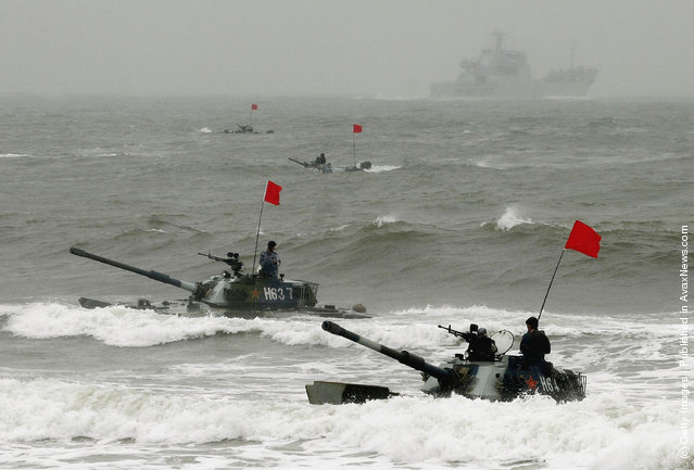 Amphibious tanks of the Chinese People's Liberation Army land on a beach