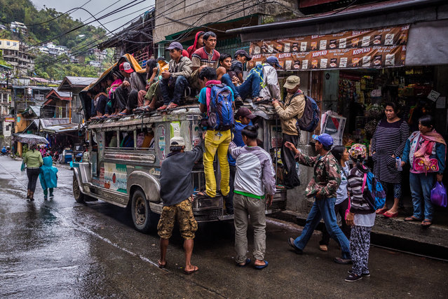 This jeepney is heading from Banaue town in Ifugao Province to the countryside (during rush hour). Although riding on the roof is prohibited, people still do it in areas where transport provision is poor. (Photo by Claudio Sieber/Barcroft Media)