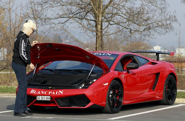 Sonja Heiniger, 76 years old, looks under the hood of her Lamborghini in Jona, Switzerland, March 20, 2015.  Supercar makers are like teenage boys at a high school dance, according to business consultant Belinda Parmar. They don't have a clue how to speak to women. They may need to learn, and quickly. With the number of financially independent women on the rise across much of the world, high-performance carmakers risk losing a potentially big market to more adaptable rivals. (Photo by Alessandro Garofalo/Reuters)