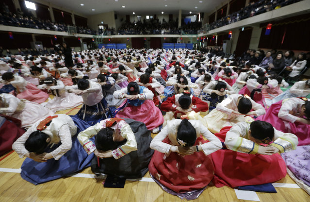 In this Thursday, February 14, 2019, file photo, South Korean seniors clad in traditional attire bow during a joint graduation and coming-of-age ceremony at Dongmyung Girls' High School in Seoul South Korea. (Photo by Ahn Young-joon/AP Photo)
